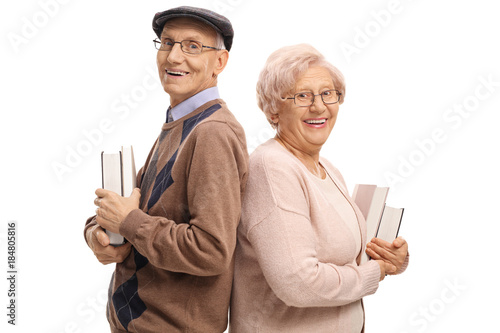 Elderly man and an elderly woman with books Poster