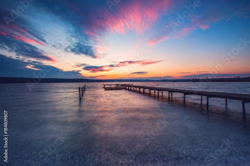 Aluminium Nachtblauw Wooden Dock and fishing boat at the lake, sunset shot