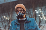 portrait of young man in respirator and hat - 184813464