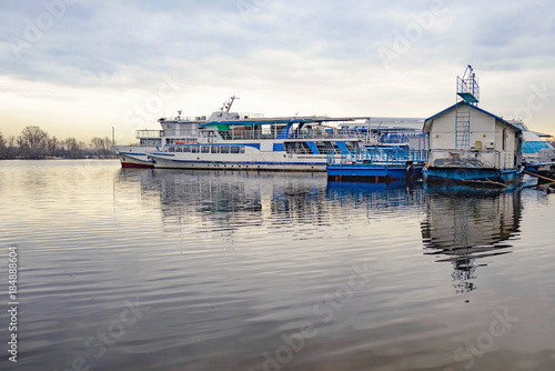 Foto op Plexiglas Kiev Boats on the Dnieper in Kiev, Ukraine during a gray winter afternoon