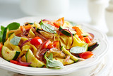 Tagliatelle with zucchini, pepper and red onion - 184907043
