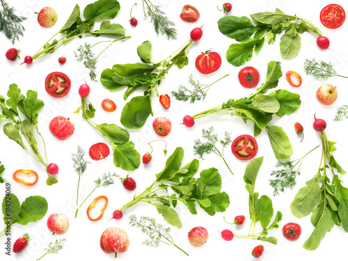 The concept of healthy eating. Pattern composition from vegetables and fruits, top view. Food background, wallpaper. Tomatoes, radish with leaves, pepper, berries, apples isolated on white background. - 184924069