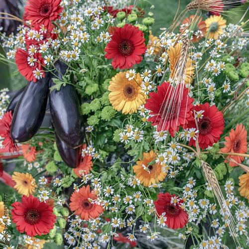 Aluminium Gerbera Beautiful floral background of gerberas, field chamomiles and ripe eggplant.