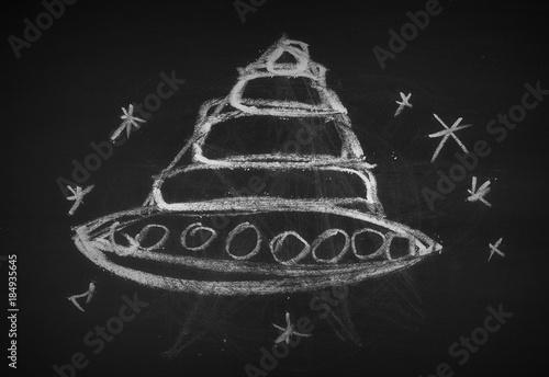 Foto op Canvas UFO Flying saucer, UFO symbol, sign on chalkboard, blackboard texture