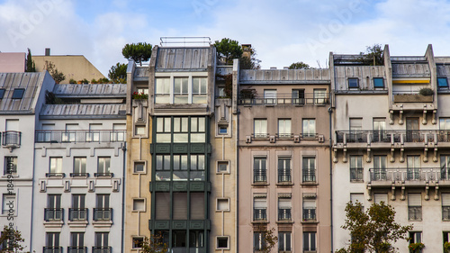 PARIS, FRANCE, on October 30, 2017. The sun lights the city street and typical architectural parts of houses of in downtown. Building facade fragment,  - 184941013