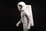 Side view of cheerful young male astronaut wearing helmet and hyperbaric astronaut protective suit is hardly moving. He is looking aside with smile. Isolated background. Cosmonaut concept - 184952813