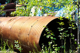A rusty culvert laying in a scape metal yard - 184968036