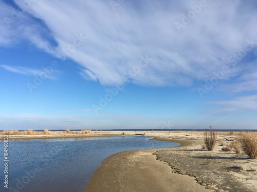 sand dunes and clouds by Chesapeake Bay