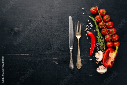 Fotobehang Kersen Preparation for cooking. Cherry tomatoes. Fresh vegetables and spices on a wooden background. Top view