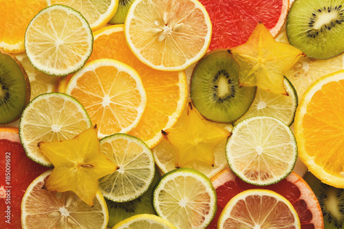 Exotic fruits slices background - 185009692