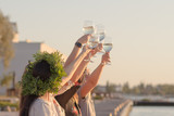 Summer party of young beautiful womans with wine, sea resort relaxing in sunny day   - 185014211