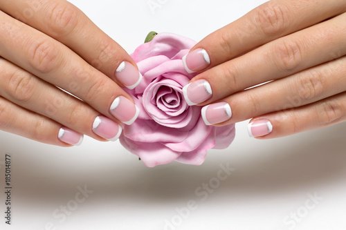 Papiers peints Manicure wedding French manicure with silver on short square nails with a pink rose in hands