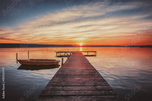 Foto auf Acrylglas See sonnenuntergang Small Dock and Boat at the lake. Hdr lsndscape view.