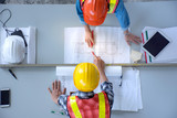 Top view of group of engineering team is meeting, planning construction work,looking paper plans at construction site,overhead view,Concept for team work - 185026456