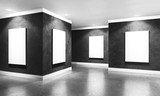 Modern concrete gallery room with directional spotlight and frames. Product artwork exhibition mock up. White isolated art frames. 3d rendering illustration of interior with black plaster walls in per - 185038414