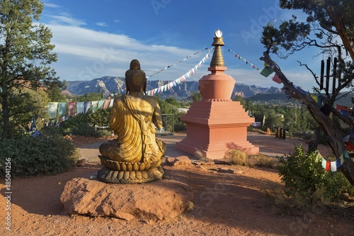 Poster Arizona Amitabha Stupa, Buddha Statue and Prayer Flags with Distant Red Rock Landscape in Peace Park, Sedona Arizona