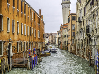 Sidestreet canal in Venice during a November rainstorm