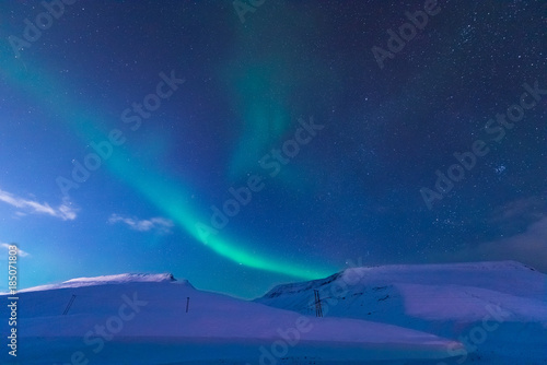 Fotobehang Nachtblauw The polar arctic Northern lights aurora borealis sky star in Norway Svalbard in Longyearbyen city the moon mountains