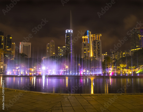 Foto op Canvas Kuala Lumpur Colourful fountain in the night with nobody, Kuala Lumpur city centre