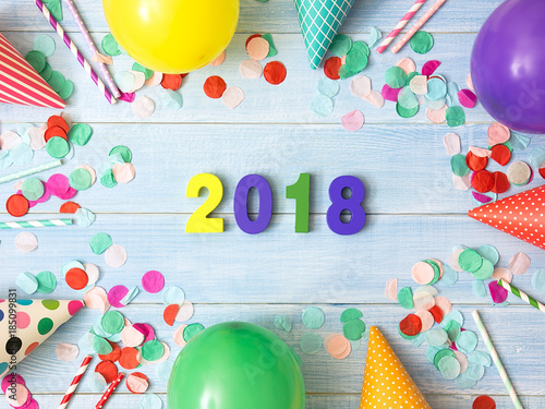Colorful wooden number 2018 and party decoration with colorful balloon, confetti, carnival cap and streamer Poster