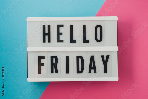 Hello Friday- text on a display on blue and pink bright background.