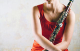 Woman in red with clarinet - 185130631