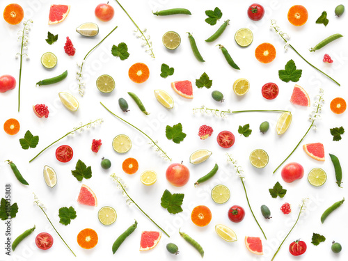 Pattern of of flowers and fruits. Abstract food background, top view, flat lay. Composition of  lily of the valley, currant leaves, tangerines, tomatoes, grapefruit, isolated on white background. - 185135808