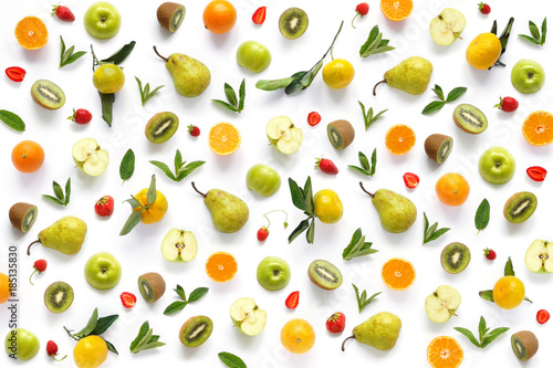 Pattern of  fruits. Abstract food background, top view, flat lay. Composition of pears, apples, mint leaves, kiwi, tangerines and oranges isolated on a white background. Healthy eating. - 185135830