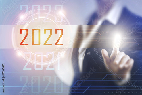 Poster Business women touching the 2022 screen