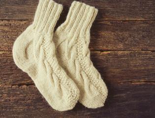 beautiful warm woolen socks on wooden surface