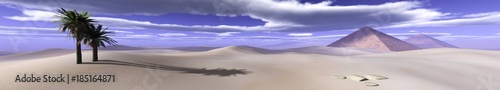 pyramids with palm trees in the desert under the sky with clouds  - 185164871