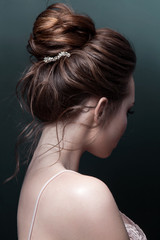 Model brunett Woman with perfect hairstyle and creative hair-dress, back view. © redchanka