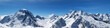 Leinwanddruck Bild - Panoramic view of snow-capped mountain peaks