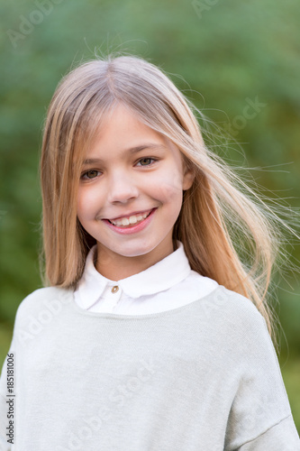 Foto Murales Girl with blond long hair smile on natural landscape