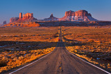 A road leading to Monument Valley with red truck going at camera, Usa