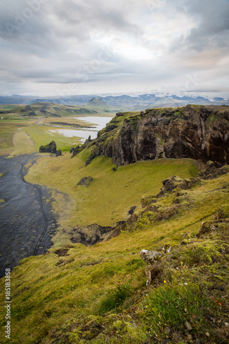 Tuinposter Donkergrijs Scenic, landscape view of mountains, glaciers, lakes, and a beach in Iceland.