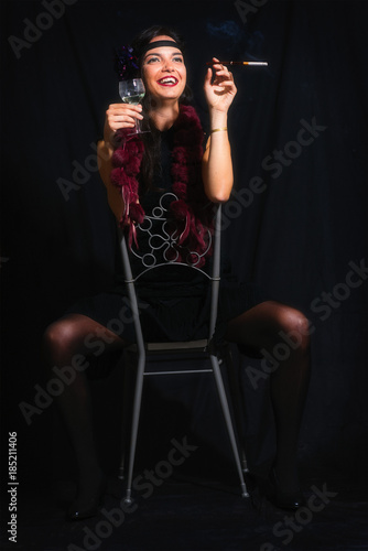 Poster Chicago 30s woman sitting backwards on chair with alcohol and cigarette