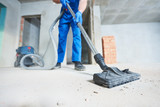 construction cleaning service. dust removal with vacuum cleaner - 185237870