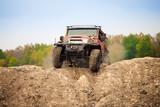 Classic off road car moving on dirt terrain