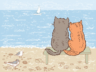 Two cats looking at the sea