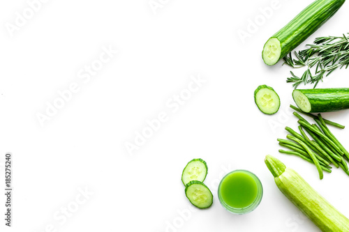 Wellness elements. Green detox drinks with cucumber, asparagus and verdure on white background top view copyspace