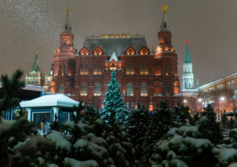 Christmas trees at the Manezh Square in Moscow on the background of the Historical Museum and the Kremlin