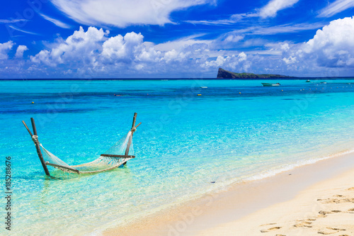 Fotobehang Tropical strand Relaxing tropical holidays with hammock in the turquoise sea.