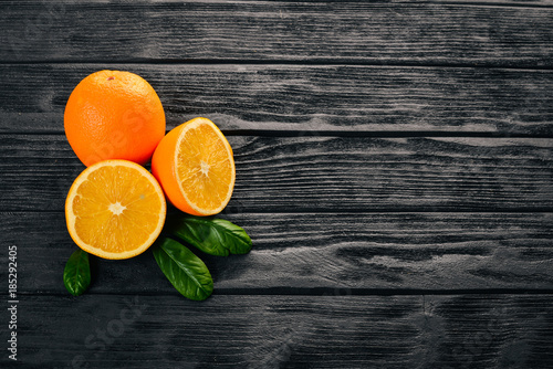Orange on a wooden background. Top view. Free space for text.