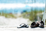 Sandals on the boardwalk by the beach - 185294082