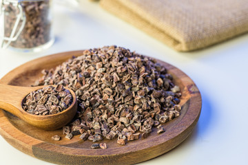 Cocoa beans and cacao powder - closeup with detail macro shot