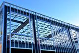Steel framework of new commercial building under construction. - 185310292