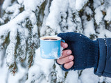 Cups of hot coffee on the snow. Christmas landscape. - 185339230