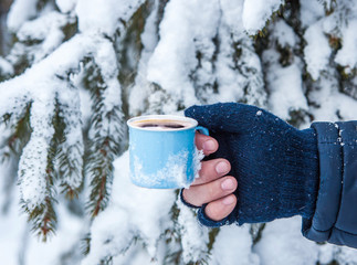Cups of hot coffee on the snow. Christmas landscape.