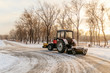 tractor cleans snow in the park, cleaning equipment